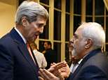 Then-Secretary of State John Kerry (left) is seen with Iranian Foreign Minister Mohammad Javad Zarif in 2015. Kerry met with Zarif about two weeks ago for secret talks in New York