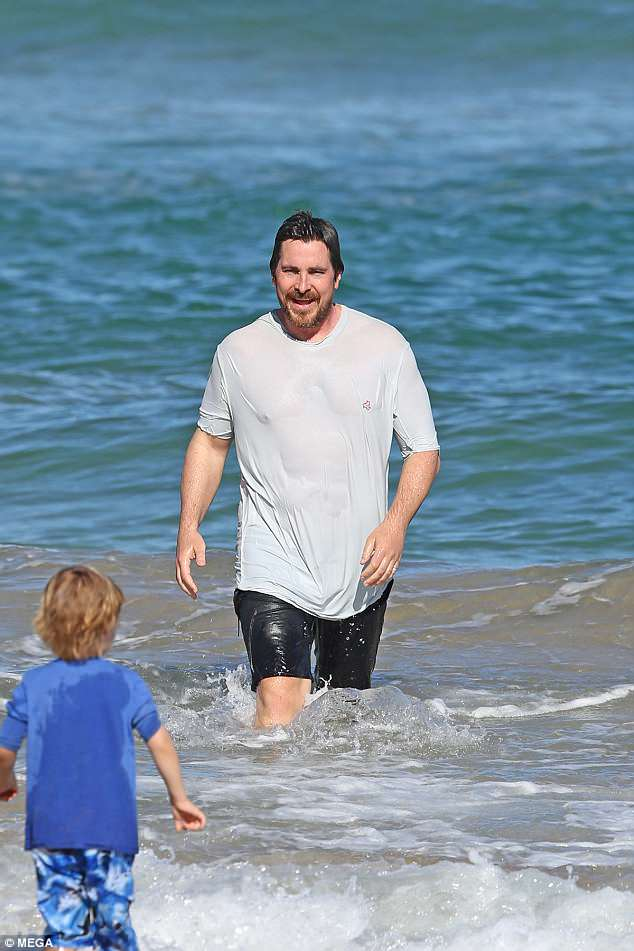Family time! Even Christian Bales needs to take a break from his arduous schedule to enjoy a tropical vacation from time to time