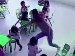 The mean teacher reaches out and pulls the chair out from under the girl as she sits down