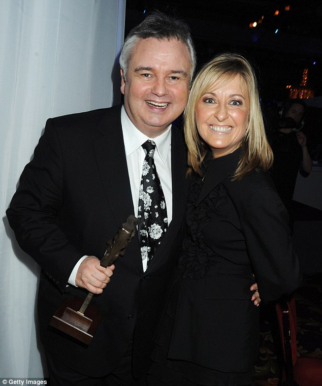 'Monetarily I was well adrift of my on-screen partner who also had 'perks' that I clearly wasn't deemed worthy of,' Phillips wrote (above: with her former co-presenter Eamonn Holmes)