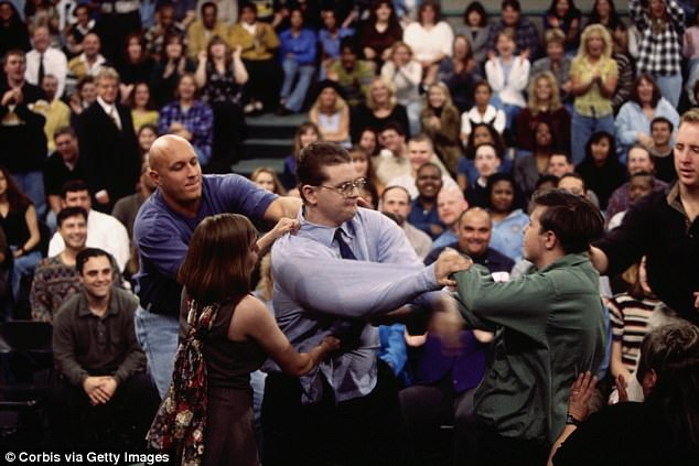 Muscling in: The former marine and police officer, pictured in the blue t-shirt, had a starring role trying to keep the peace on The Jerry Springer Show