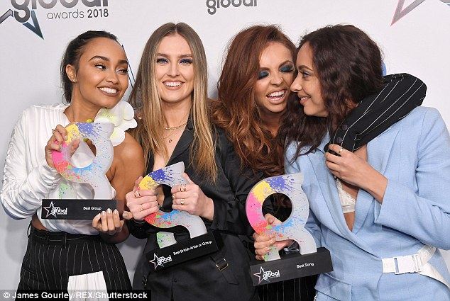 Leading ladies:The pop star perhaps let her hair down in celebration of Little Mix's recent success at the Global Awards (Leigh-Anne Pinnock, Perrie Edwards, Jesy Nelson, and Jade L-R)