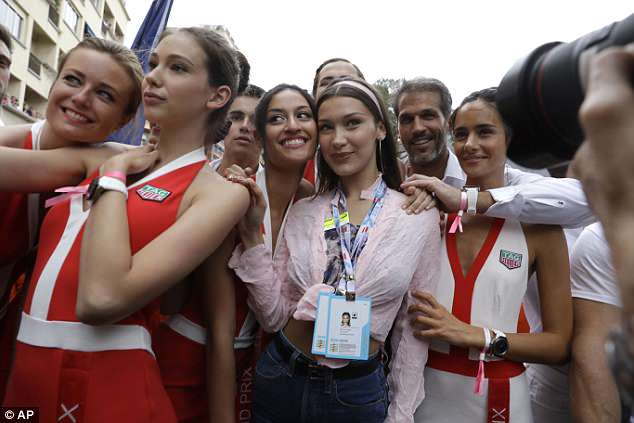 Part of the team: Bella also joined the grid girls on the racetrack ahead of the race