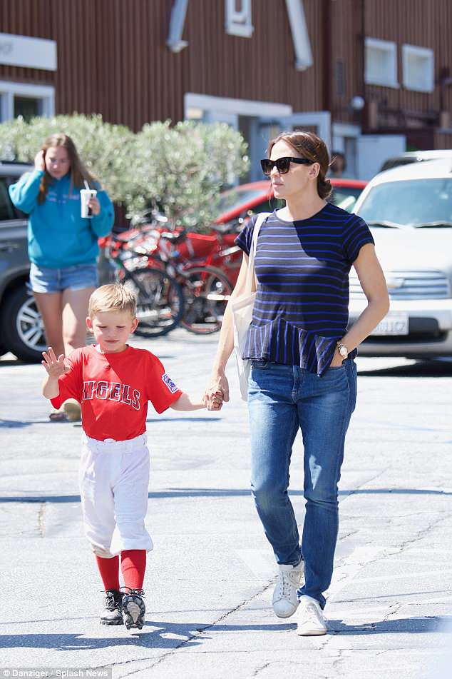 Hold my hand: The mother-son duo seemed at ease on a stroll after the baseball game