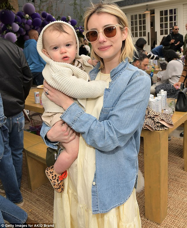 Pretty: Meanwhile, Emma Roberts, 27, looked ready for spring in a pastel yellow dress layered under a denim button-down