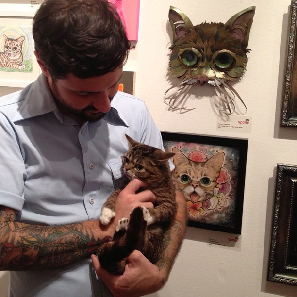 Lil Bub & Mike Bridavsky in front of our mask.