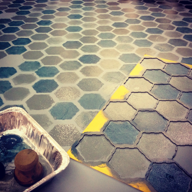 Stenciling a faux tile floor with multiple metallic teals.