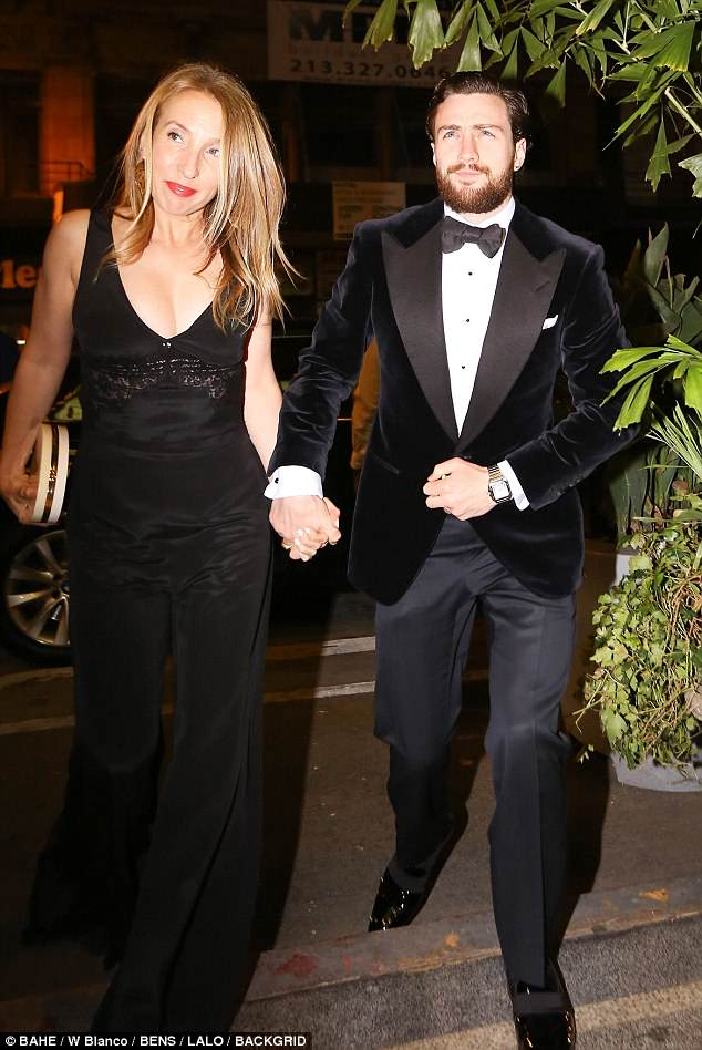 Sharp: Aaron Taylor-Johnson and wife Sam cut a handsome couple