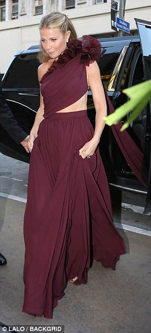 Rehearsal dinner? However Gwyneth herself wore maroon rather than white, suggesting the extravagant party was not the couple's actual wedding