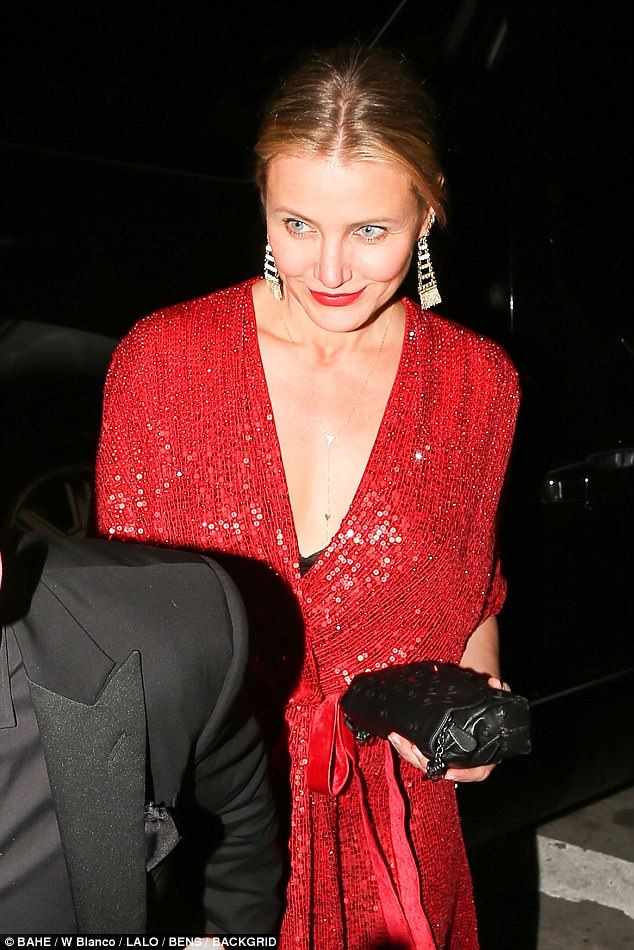 Lady in red: Cameron Diaz arrived in a shimmering red sequinned gown
