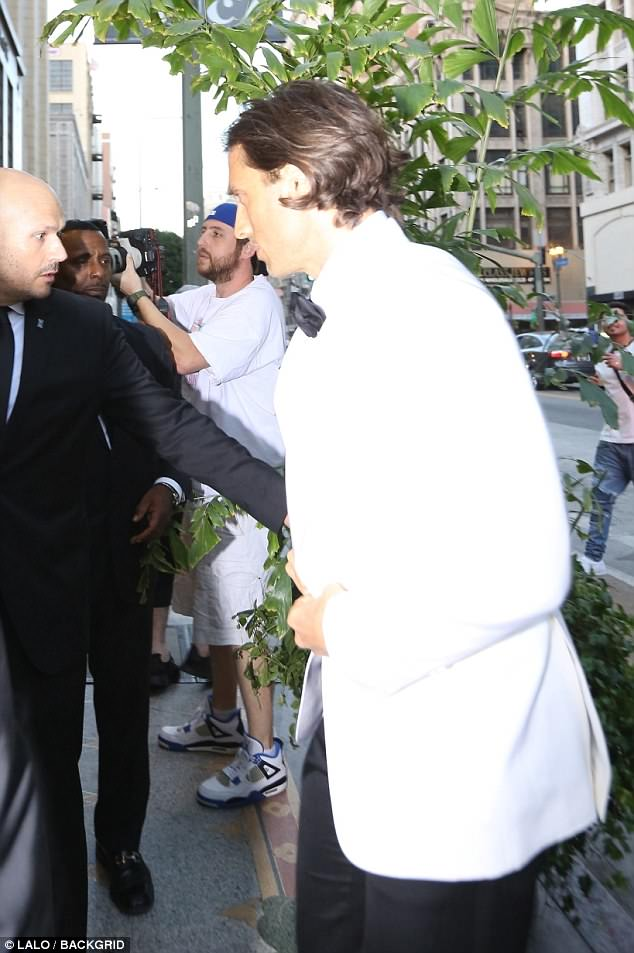 Hubby in the making: Brad meanwhile arrived in a white dinner jacket