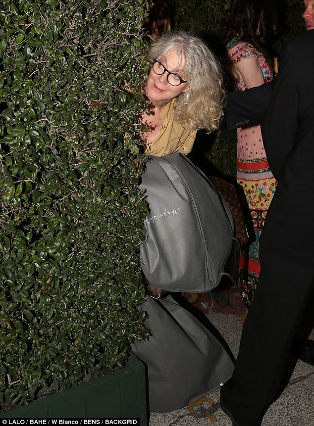 Sheepish: Gwyneth Paltrow's  Blythe Danner  was seen carrying a dress from bridal designer Monique Lhuillier out of of the actress' 'engagement party' at the Los Angeles Theater on Saturday