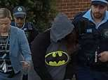 The mother, 20, was arrested wearing a Batman  hoodie about 7.30am Wednesday
