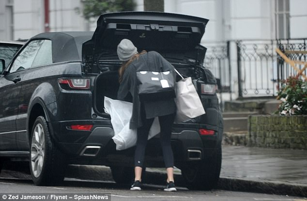 Giving nothing away:Millie cut a casual figure as she stepped out, clad in a slouchy grey sweater paired with black leggings and white and black Nike trainers
