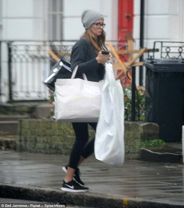 Is that Meghan Markle's gown?The former Made In Chelsea star, 28, who got engaged in July, looked focused as she arrived at the fitting, with the lavish gown carefully hidden under a white dress bag
