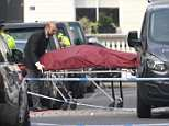 A body is removed from the scene in Chelsea this morning following the incident last night
