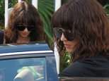 Asia Argento is seen left leaving her home in Rome on Saturday