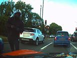 Terrifying dashcam footage on the London's North Circular Road in Finchley shows a moped mugger seconds before he jumps on a motorist's bonnet in a vicious attack