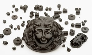 A jet pendant depicting the head of Medusa alongside beads that formed a necklace. The rare items will be on display at the Museum of London Docklands.