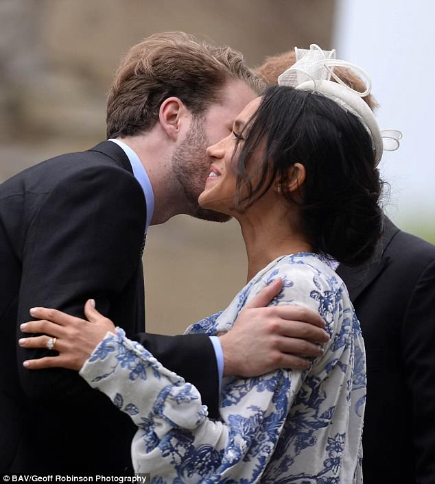 Meghan looked at ease as she greeted Harry's cousin Louis,Viscount Althorp, at the wedding