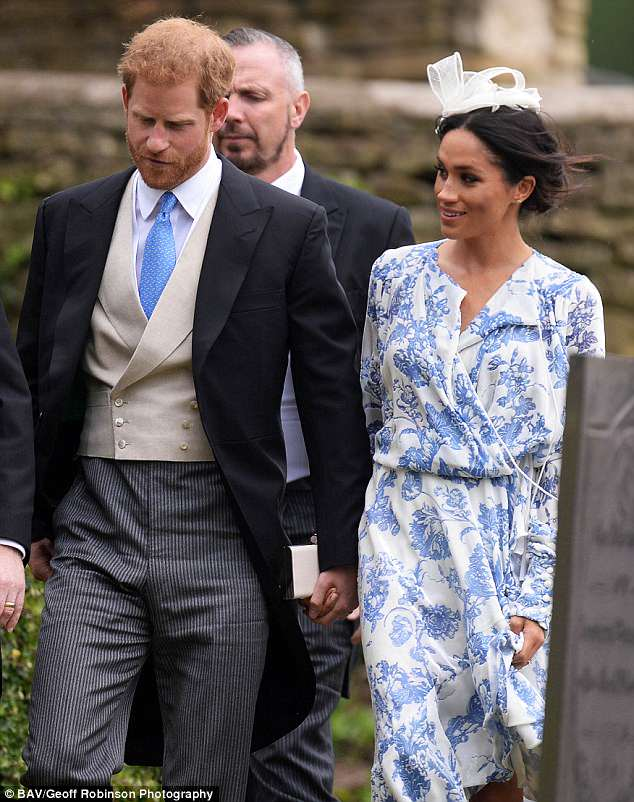 The couple held hands as they walked into the church ceremony in Linolnshire yesterday