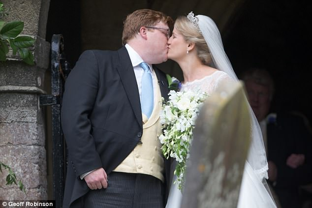 The bride and groom kissed at the entrance to the church after the short service