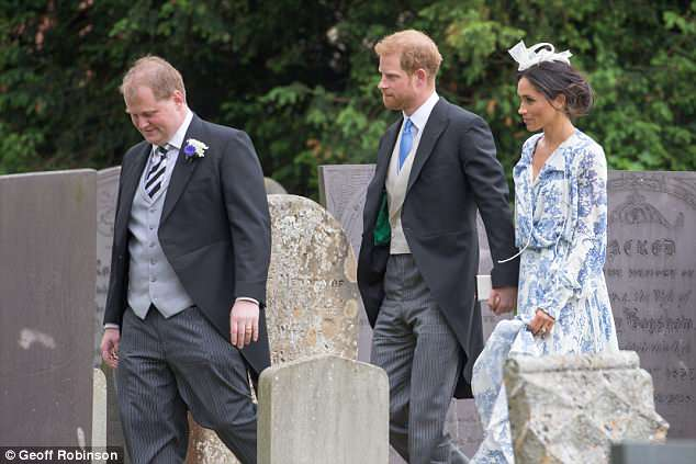 Harry looked proud to have his new wife on his arm as they made their way into the church