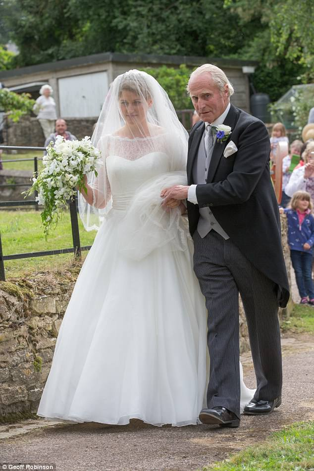 The beautiful bride was escorted to the church by her fatherNeil McCorquodale