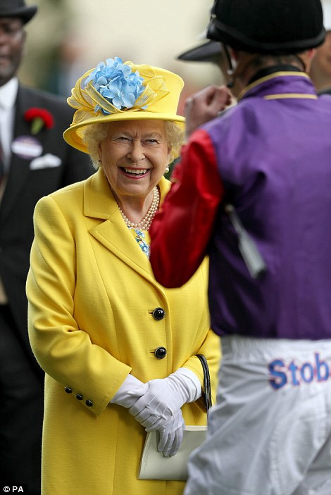 Queen Elizabeth is seen chatting to jockey James Doyle, who rode her horse Fabricate on Tuesday