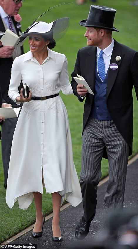 Meghan opted for an elegant white shirt dress by wedding designer Givenchy