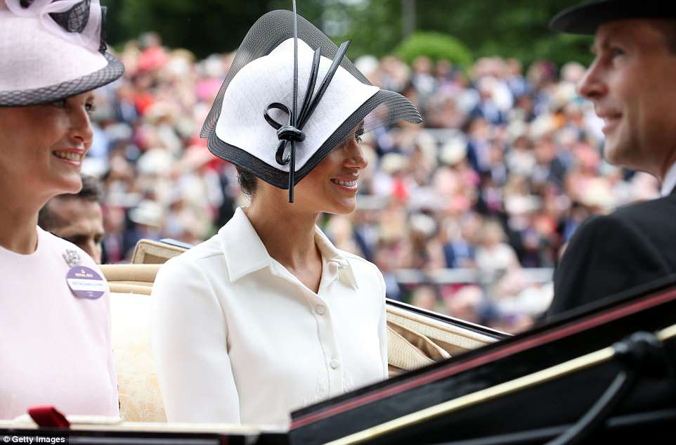 Meghan opted for a stylish fascinator by Philip Treacy (above) as she joined Sophie and Prince Edward during the procession