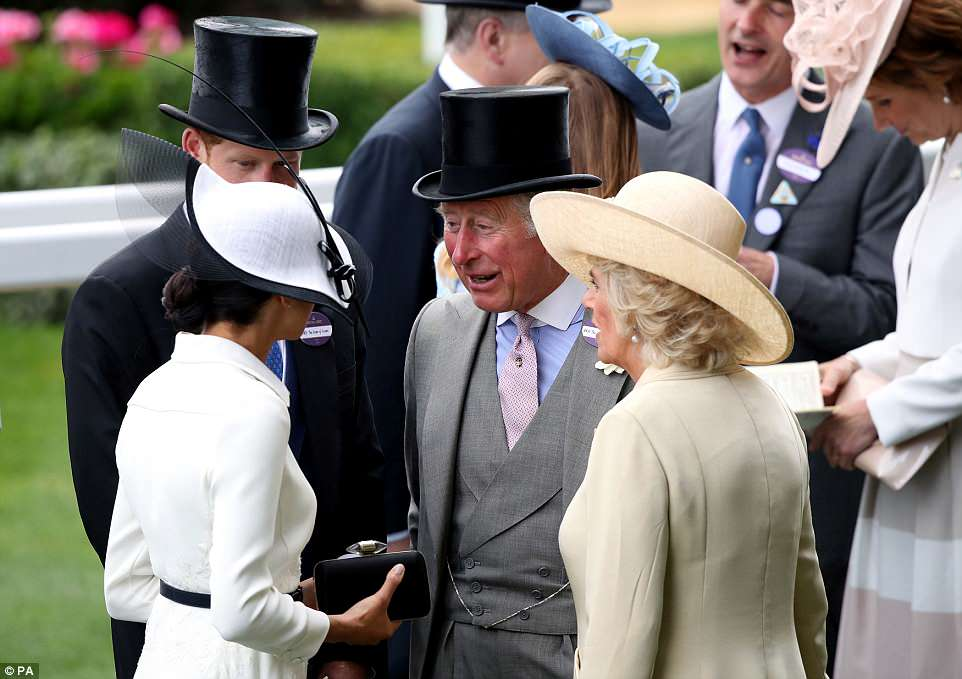 Harry and Meghan were seen enjoying an animated conversation with Prince Charles and Camilla at Ascot today