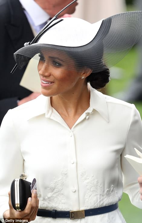 She finished off her look with a striking hat by Philip Treacy