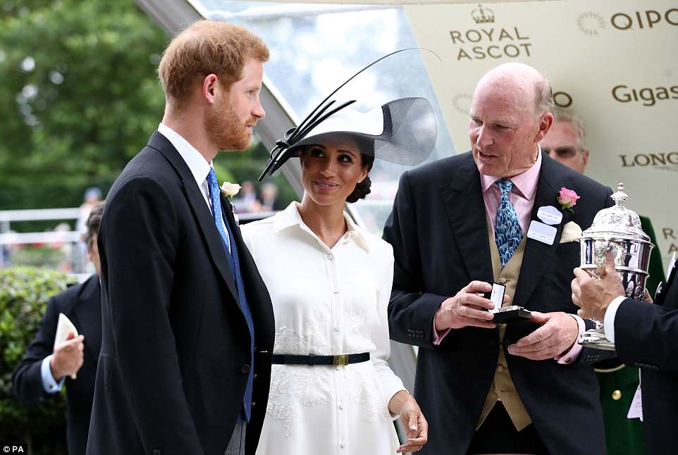 The Duke and Duchess of Sussex looked relaxed as they presented the awards on stage at the end of a day of racing