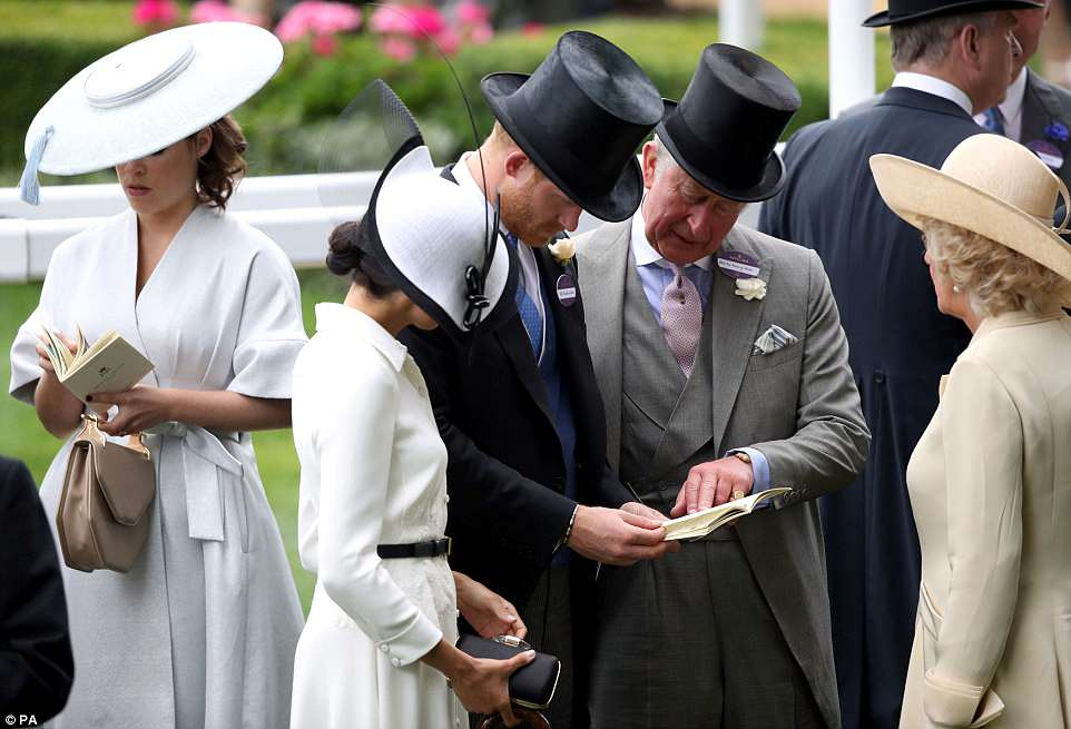Prince Harry and Charles were seen looking at the programme as they were joined by Meghan and Camilla at Ascot today