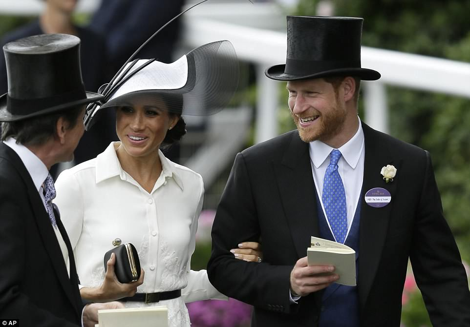 The Duke and Duchess of Sussex looked to be in good spirits as they chatted to the Queen's bloodstock and racing advisor