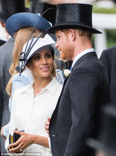 Meghan was seen looking up lovingly at Harry while at Ascot