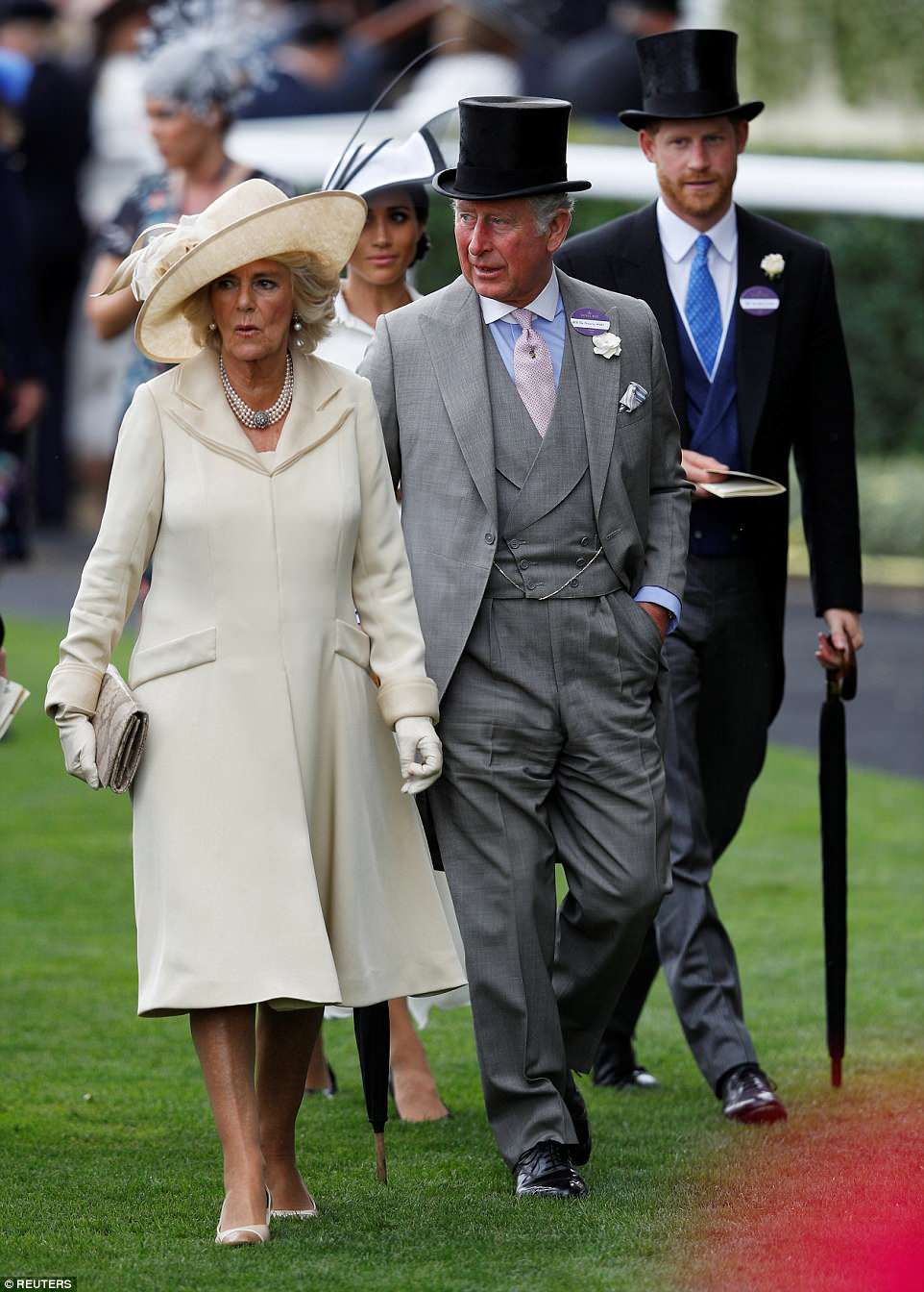 The Duchess of Cornwall opted for an elegant cream ensemble as she arrived with Prince Charles at the Berkshire racecourse