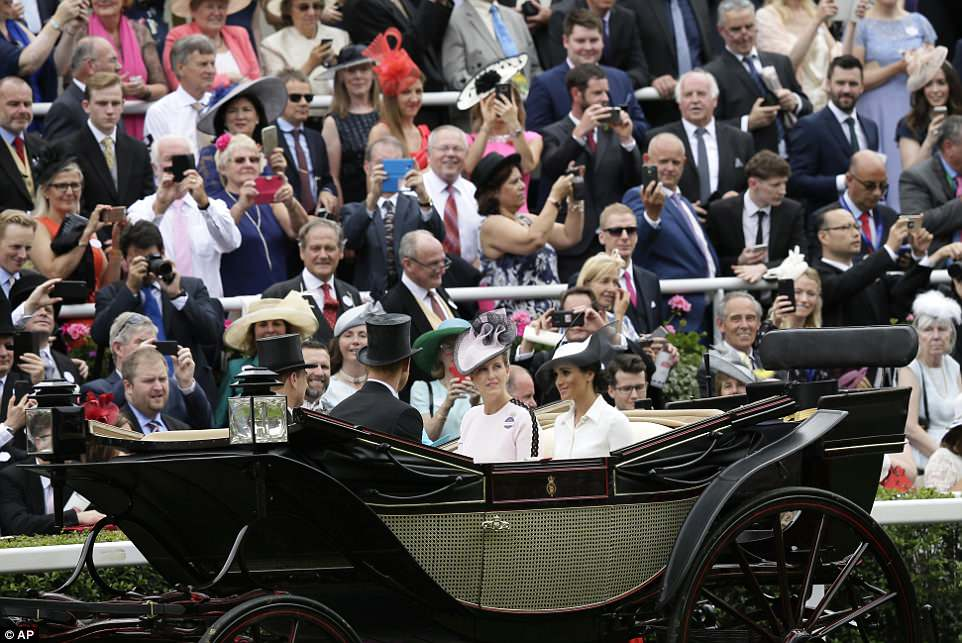Meghan and Harry rode with Prince Edward and the Countess of Wessex during the traditional carriage procession today