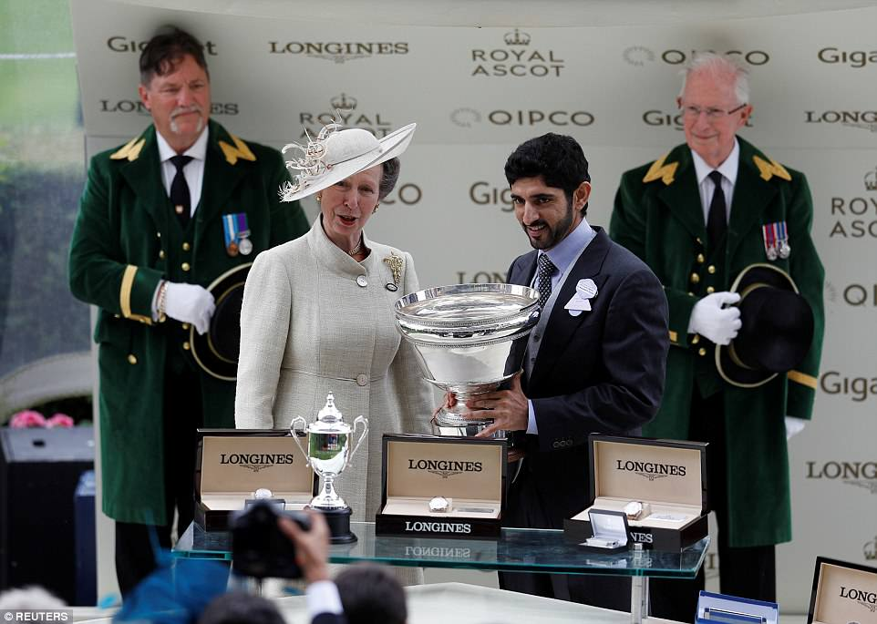 Princess Anne presented a trophy toHamdan bin Mohammed Al Maktoum at the end of the first day of racing today