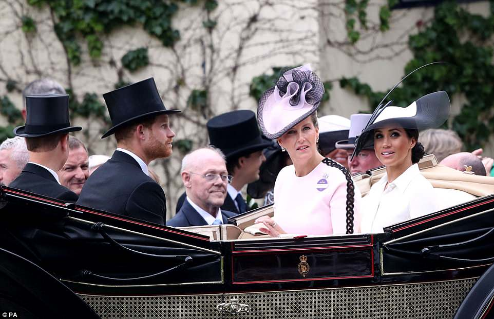 Meghan sat next to Sophie, the Countess of Wessex, during the procession today, as onlookers at Ascot watched on