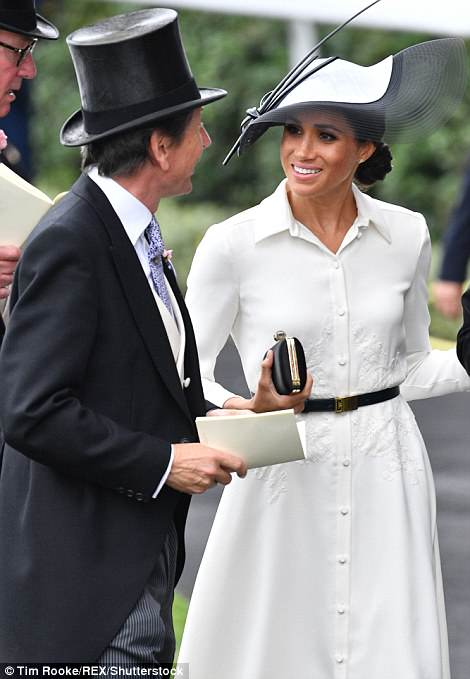 The Duchess of Sussex was seen chatting to the Queen's bloodstock and racing advisor, John Warren