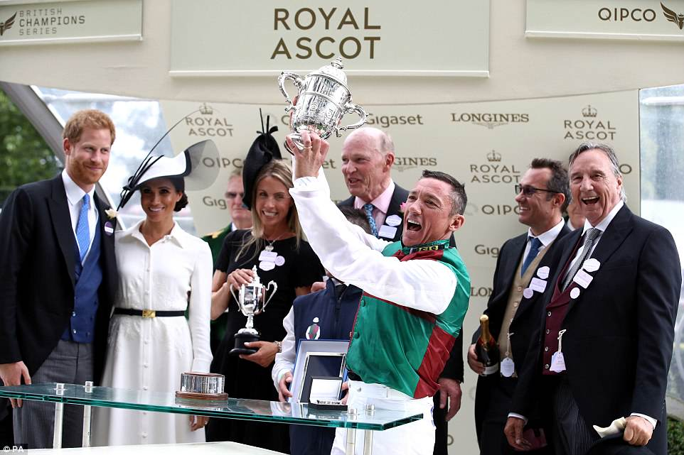 The Duke and Duchess of Sussex presented a trophy to jockey Frankie Dettori (with trophy) and trainer John Gosden (centre, back), after their horse Without Parole wonthe St James's Palace Stakes