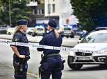 Five people were shot in the city of Malmo in Sweden. Pictured:Officers have cordoned off the scene of the shooting