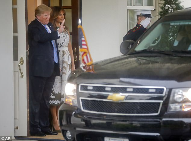 President Donald Trump, waves as he and first lady Melania Trump watch as Spain's King Felipe VI and Queen Letizia depart the White House