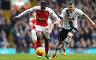 Danny Welbeck of Arsenal and Kevin Wimmer of Tottenham Hotspur compete for the ball during the Barclays Premier League match between Tottenham Hotspur and Arsenal at White Hart Lane