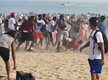 The men brawled at 7pm on Monday night when hundreds of people were still on the beach at Coney Island, soaking up the 91F heat