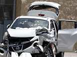 The car the women were sitting in when they were shot to death through the windshield and windows is pictured. Before opening fire, the gunman rammed his vehicle into it. He killed himself after shooting both women in what police are calling a domestic incident