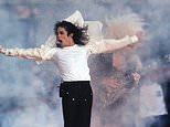 FILE - This Feb. 1, 1993 file photo shows Pop superstar Michael Jackson performing during the halftime show at the Super Bowl in Pasadena, Calif.  A musical about the King of Pop is moonwalking to Broadway. The Michael Jackson Estate and Columbia Live Stage are unveiling plans for a stage musical inspired by the life of Michael Jackson. They hope it will be ready for Broadway by 2020. (AP Photo/Rusty Kennedy, file)