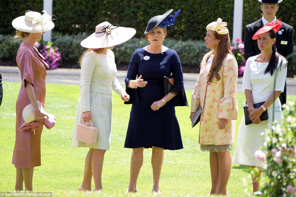 Fergie looked at ease as she chatted with her daughter an other glamorous guests as they awaited the carriage procession in the parade ring